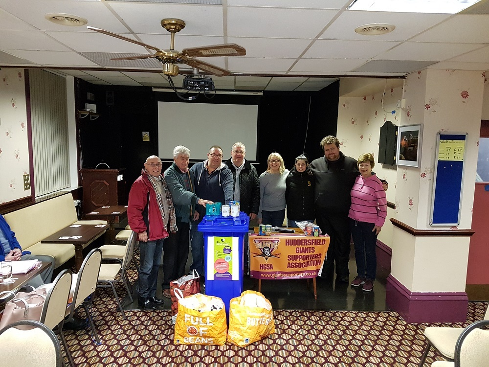 Huddersfield Giants fans hand over their donations