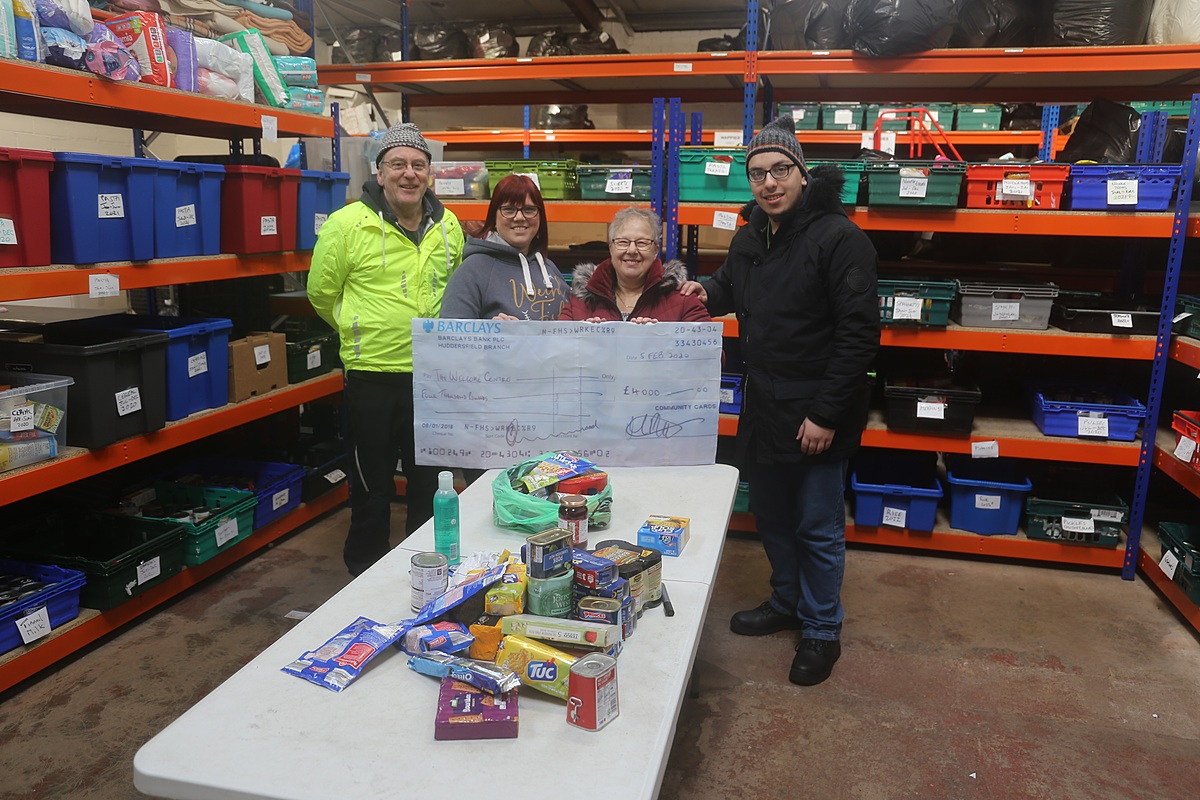 Volunteers receive latest cheque donation of £4,000 from Community Cards.