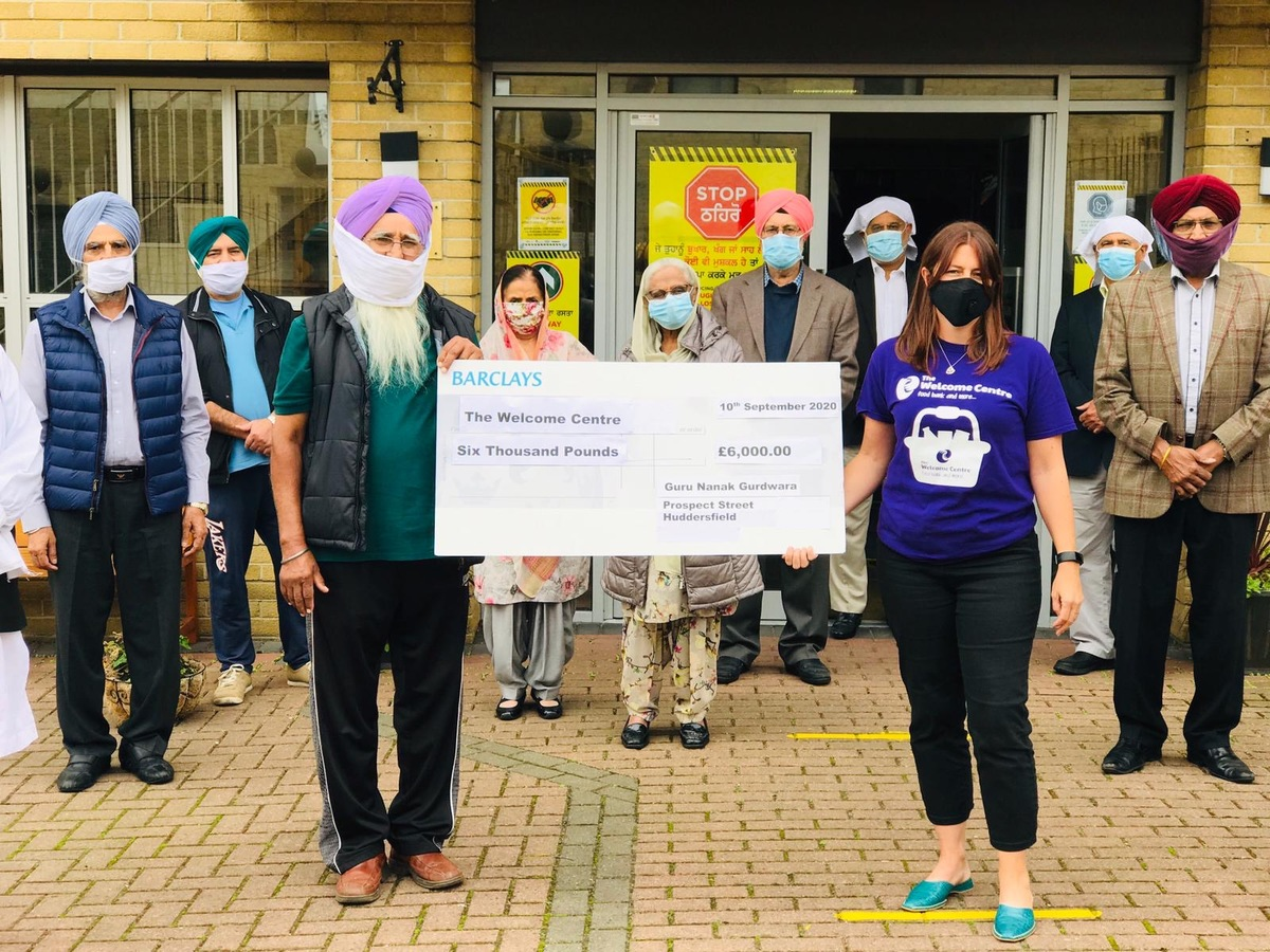 Receiving £6000 donation from Sikh Community